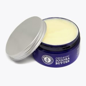 Jar of natural and organic jojoba butter with lid off.